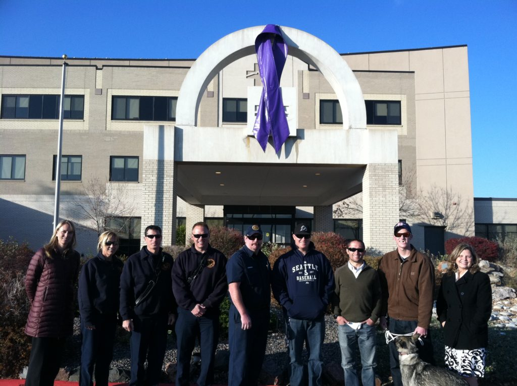 Custom flag company team hanging Jessica Ridgeways purple ribbon - a very special banner