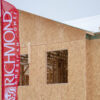 Custom Flag Company Richmond American Homes Custom Feather Flag 1 in front of new build
