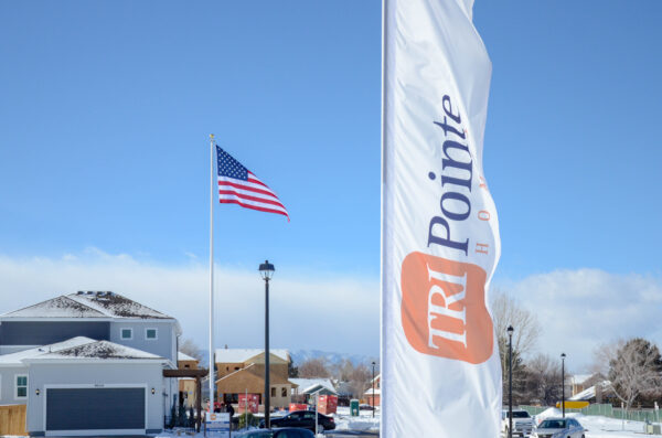 Custom Flag Company Tri Pointe Custom Feather Flag & US Flag in new community