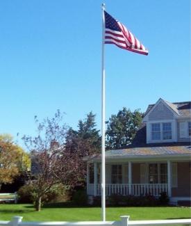 Custom Flag Company Flagpole in Yard