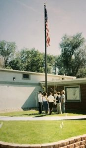 Custom Flag company building in 2004 installing flagpole
