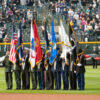 Honor Guard display of US, Colorado, POW-MIA, and Military Branch at Coors Field, Denver, CO