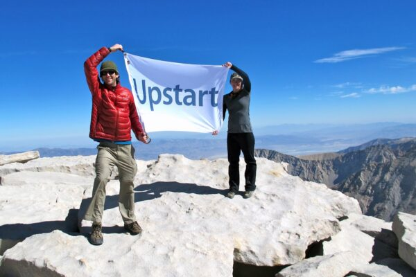 Hikers displaying Upstart custom flag