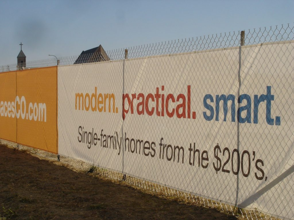 Shea Spaces vinyl banner on a fence - exposure. banners can help