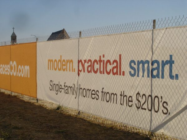 Shea Spaces vinyl banner on a fence
